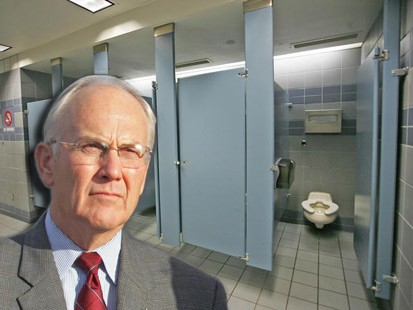 Larry Craig, a white man with gray hair, in front of a photoshopped bathroom stall
