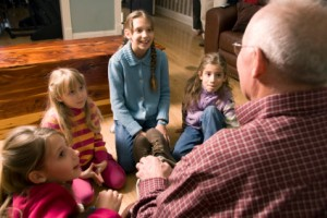 Grandfather_telling_a_story_to_Grandchildren-iStock_000008456269XSmall-300x200