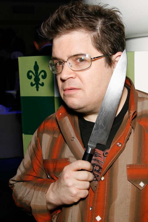 Non believer, Oswalt, clowns around with a knife